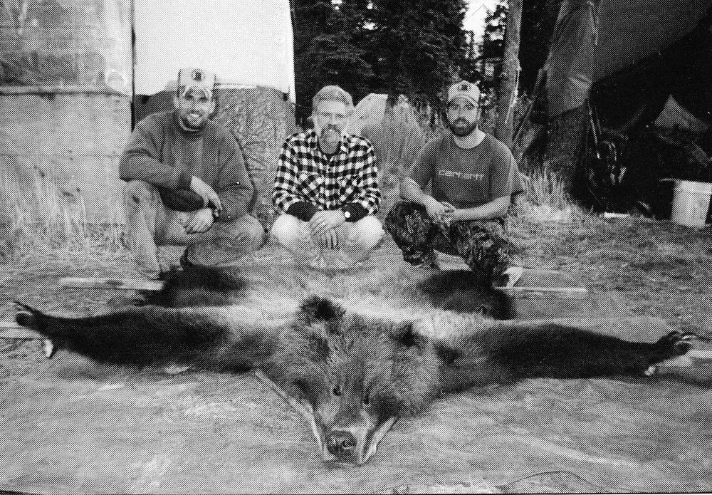 (L to R) Eric, myself and Thor with Stan Bocian's brown bear that we recovered.