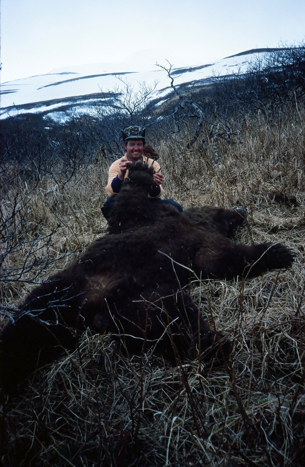 John's a happy hunter showing the bear's enormous paw.