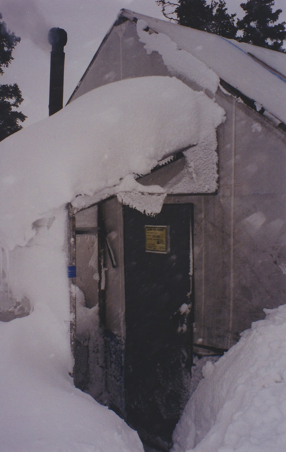 Cook tent entrance during a snow storm.