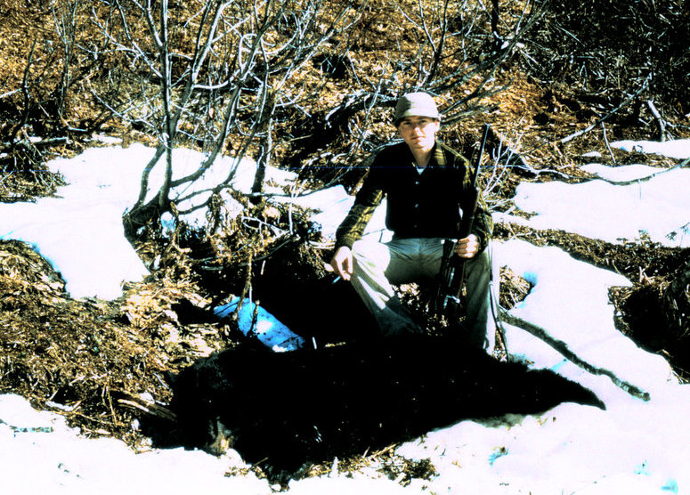 "Marv ""Buck"" Buckley with his 6' black bear."