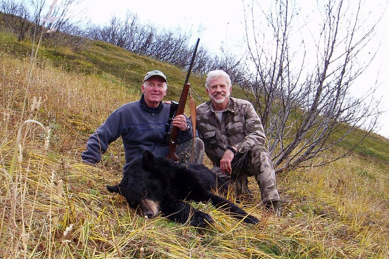 Marty and me with his black bear.  Another great memory of a fun hunt with a good friend.