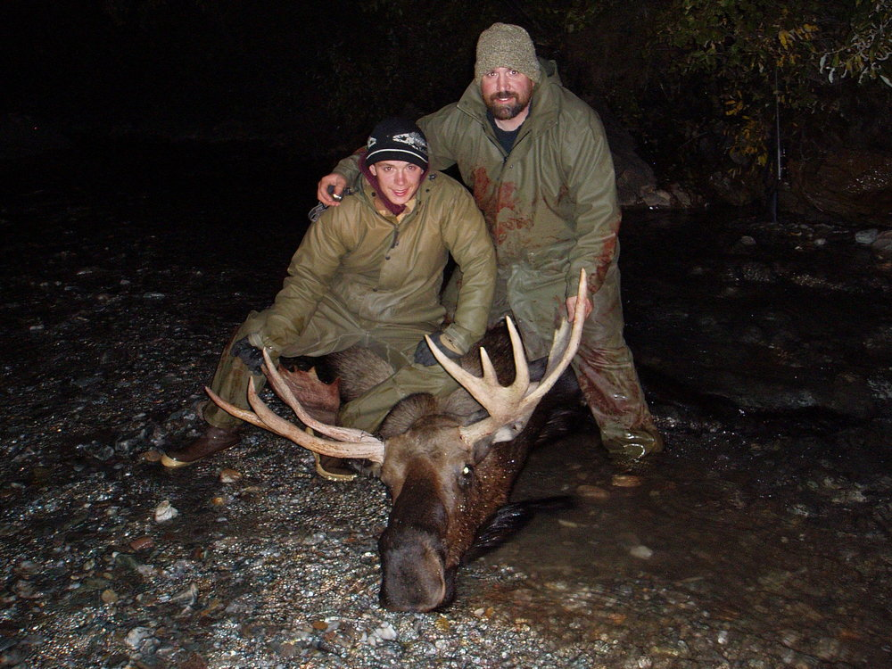 "Jens and Thor with Jens' 44"" moose.  You can see Thor is standing in the water."
