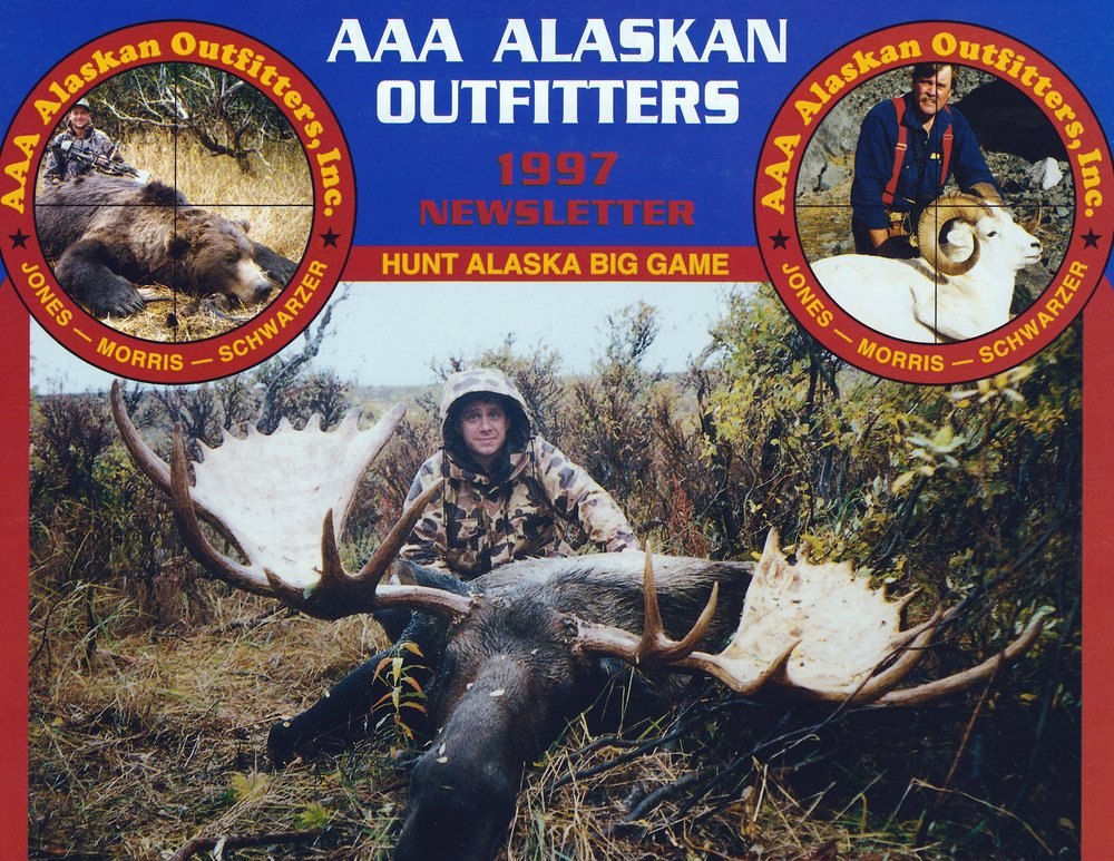 "Craig Hoskin, AZ, with his 73"" moose.  This was the largest moose taken in '97 and was taken in Western Alaska.  His guide was Sagen Juliussen.  The packers called this pack, ""the pack from hell.""  A mile and a half in a swamp going up hill the whole way!!"