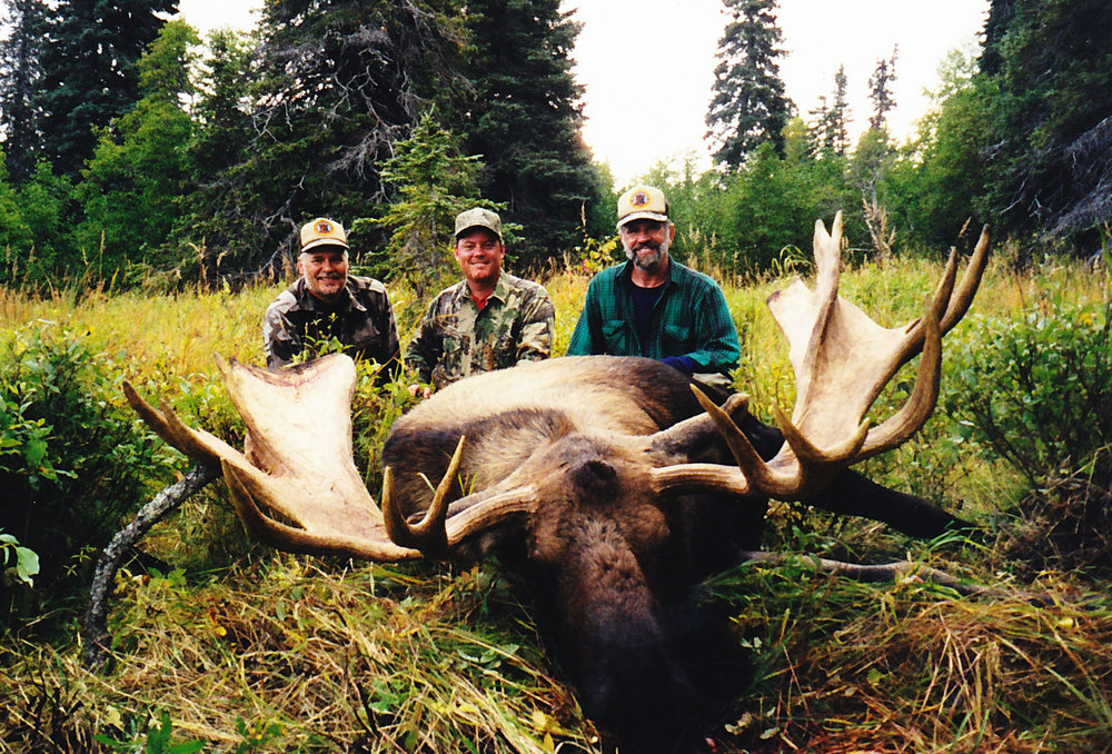 (L to R) Guide Dennis Byrne, Chris Parrack, TX, and me with Chris's 68 incher taken in Western Alaska in '99.  The moose was taken right behind base camp.