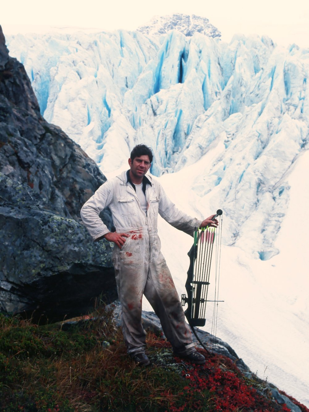 Standing with my new PSE compound bow with the rugged Trail Glacier in the background.