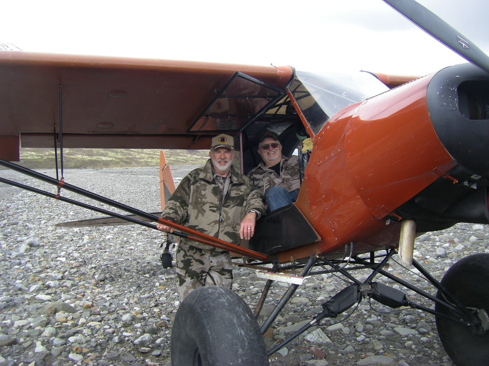 "Brent and me with Robert's ""Super Cub.""  The cub is equipped with the 34"" Alaskan Bushwheels."