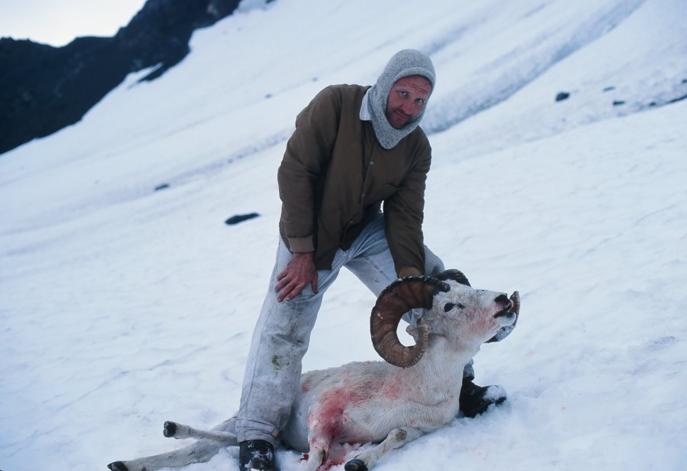 Lyle and his ram on the snowfield.