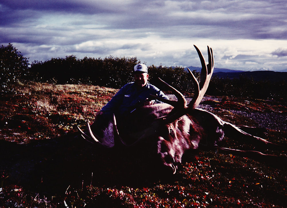 "Ted Epley with his 65"" giant moose."