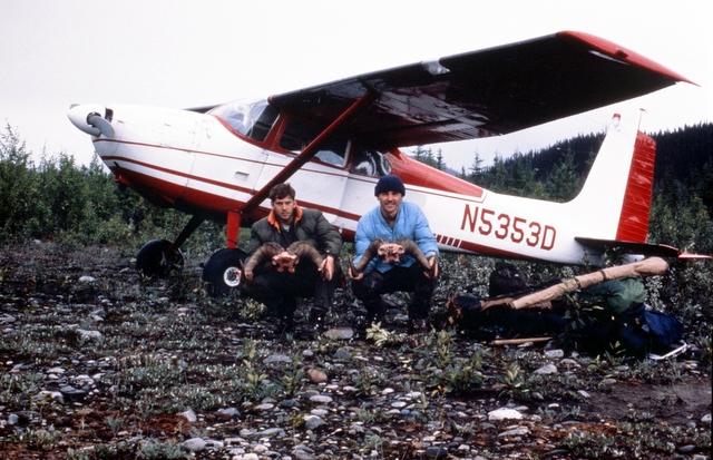 Gordy and Scottie beside Ken's Cessna 185.