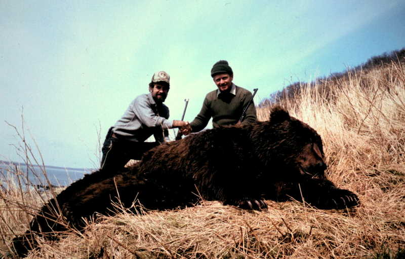 Kurt and me with his fat 10' brown bear. It took all five of us to roll him out of the alder.