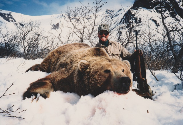 "Randy Cain with the largest brown bear AAA has ever taken. 11'3"" 30 5/16 SCI World Record at that time."