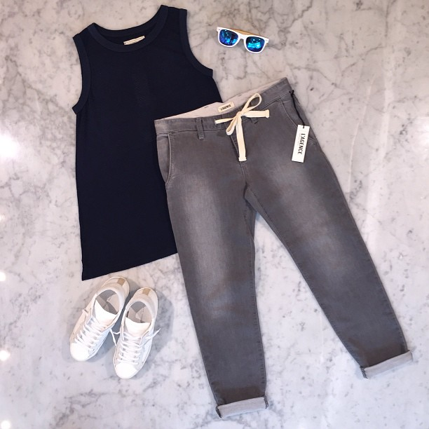 The sweat pant jean from L'Agence + Current Elliot's play on a basketball tank + Philippe Model white sneakers and One Love For All shades