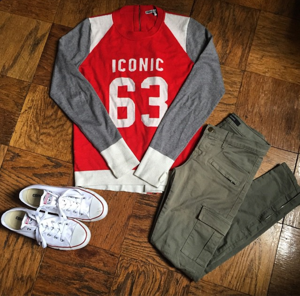"""Smells like team spirit!"" In   Pam & Gela   sweater,   J Brand   cargo pants, and low-top   Converse"