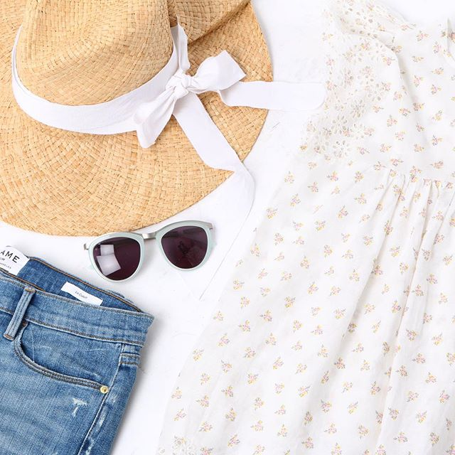 Sunshine and Summer:   Frame Denim   Shorts,   Ulla Johnson   Top,   Lola Hat  , and   Smoke X Mirrors   Sunglasses