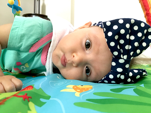 Navy and white polka dot baby turban headband from Posh Pelican Co.