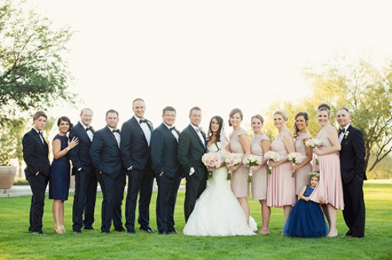 The crew! Blush bridesmaid dresses from Watters and  CoralieBeatrix . Navy blue tuxes from  T  he Black Tux