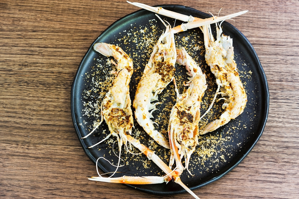 Grilled scampi and hazelnut butter from Monopole