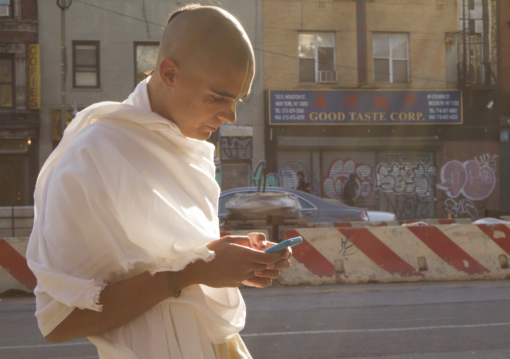 Hare Krishna monk Alex Seibel, 19, checks directions en route to pick up his visa for a trip to India.
