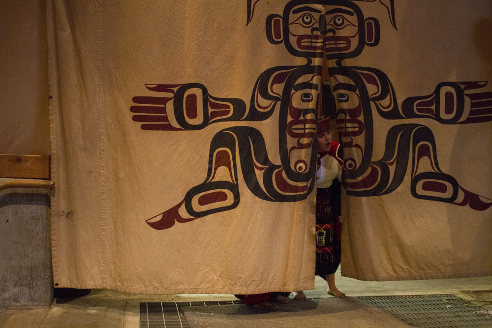 Beverley Mountain, 12, looks as other contestants take the stage during the Salmon Prince and Princess Pageant in Alert Bay, B.C.  © North Island Gazette.