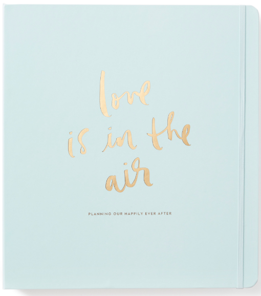 Kate Spade Bridal Planner, features a gold 3 ring binder, a pocket with gold accents, and 48 planning pages. $48 at    katespade.com   . Curvy Rose is not a paid sponsor for Kate Spade New York