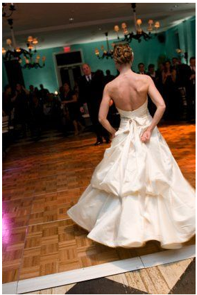 This bride chose to bustle her gown before hitting the dance floor.