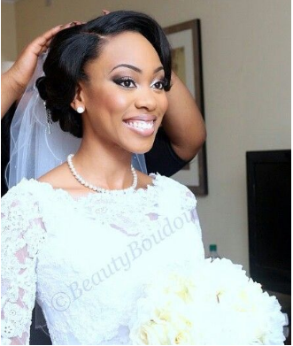 A beautiful bride getting her veil perfectly placed. @loveweddingsng