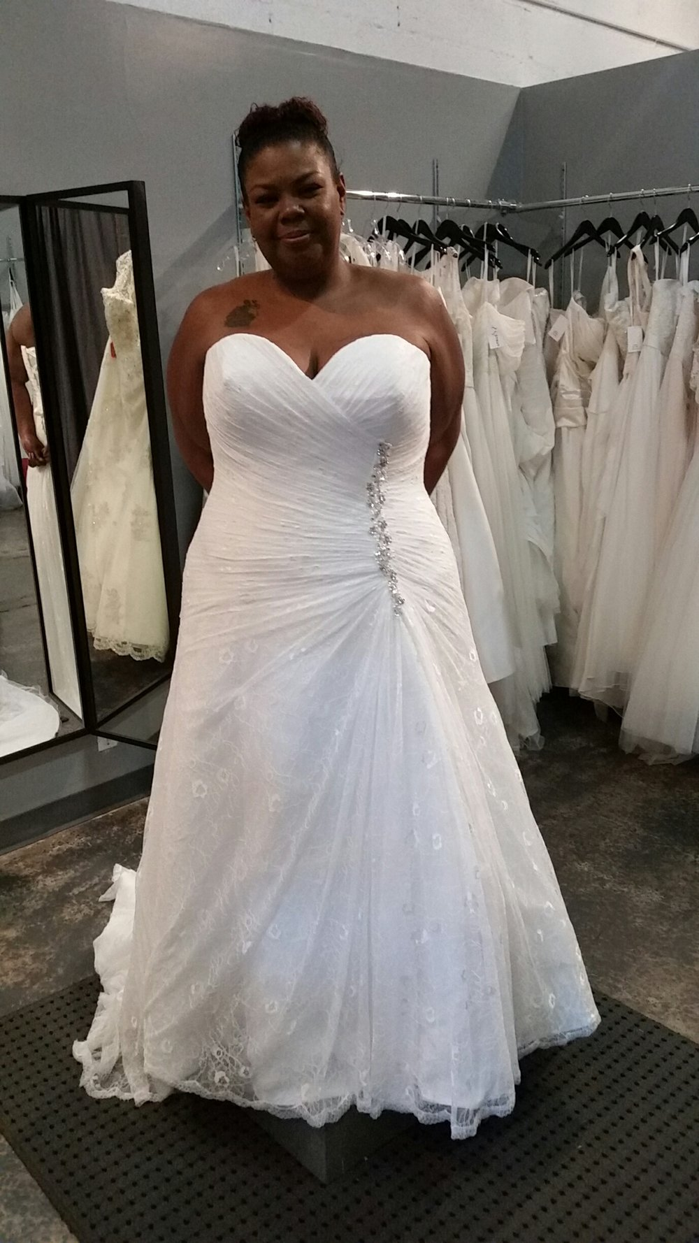 Bride in a gorgeous lace Callista bridal gown from Strut Bridal in Long Beach, CA. Curvy Rose has this dress on clearance in size 26.