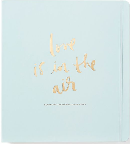 Kate Spade Bridal Planner, features a gold 3 ring binder, a pocket with gold accents, and 48 planning pages. $48 at  katespade.com . Curvy Rose is not a paid sponsor for Kate Spade New York.