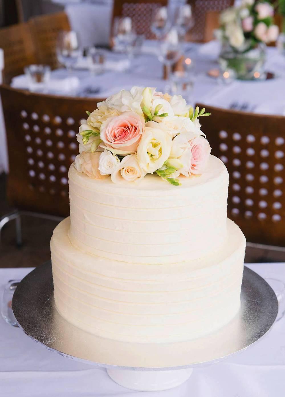 Vanilla Pod frosted Wedding Cake with fresh flowers.jpg