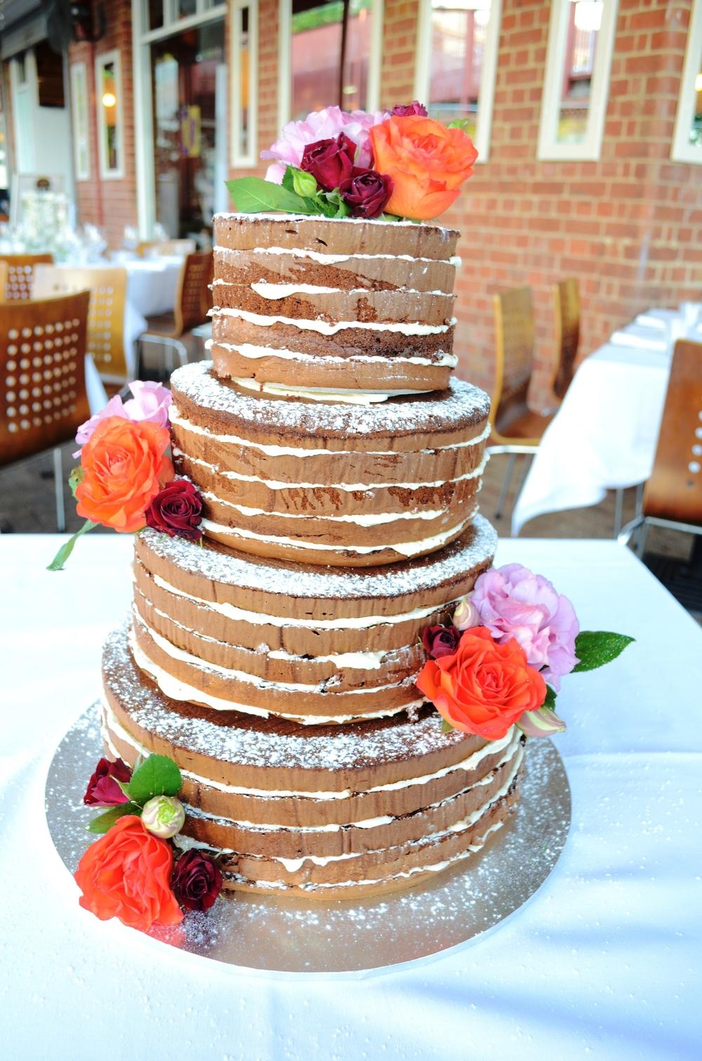 Vanilla Pod wedding cake chocolate saponge with vanilla crea, and fresh flowers by bouquet boutique.JPG