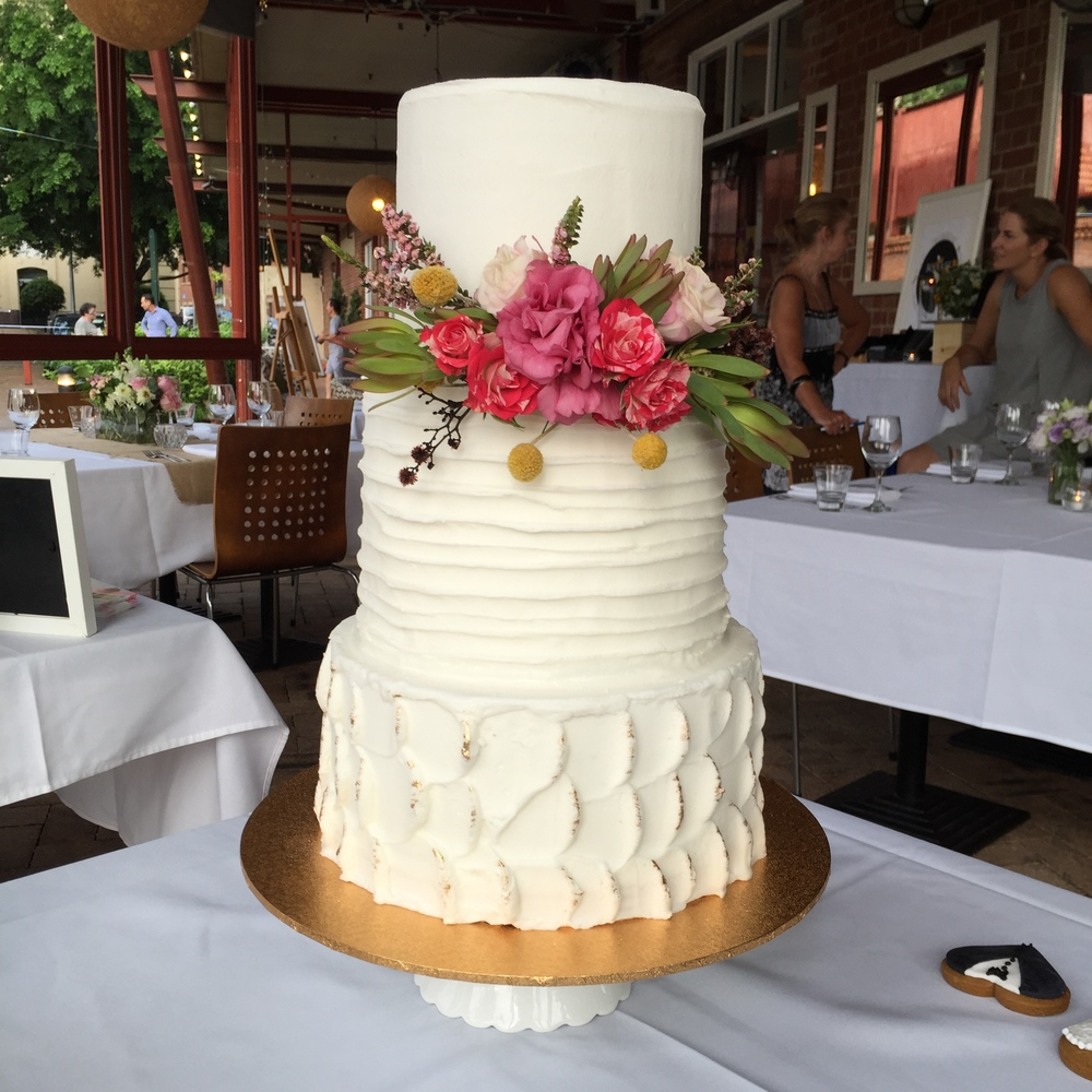 Vanilla pod Wedding Cake with fresh florals by Bouquet Boutique textured frosting dessert brisbane.JPG