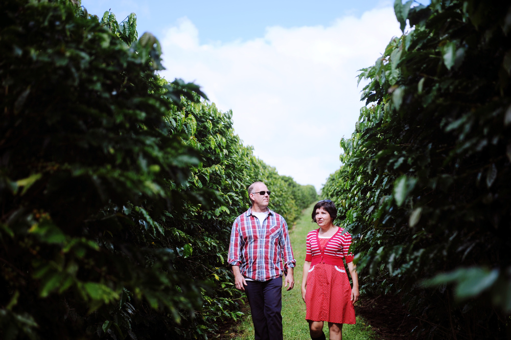 Rebecca and John at home amongst the coffee trees.