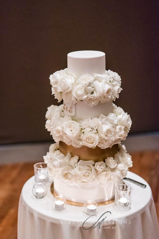 4 tier fondant white and gold wedding cake Brisbane modern stylish Vanilla Pod Wedding Cake.jpg