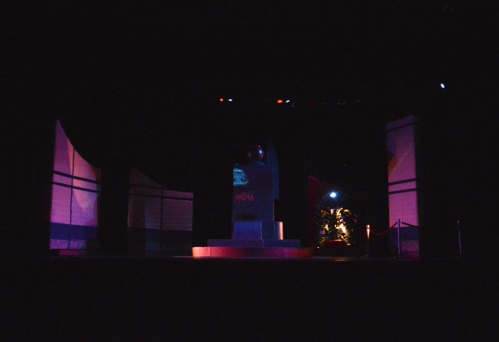 Scene transition into a theatre exterior.