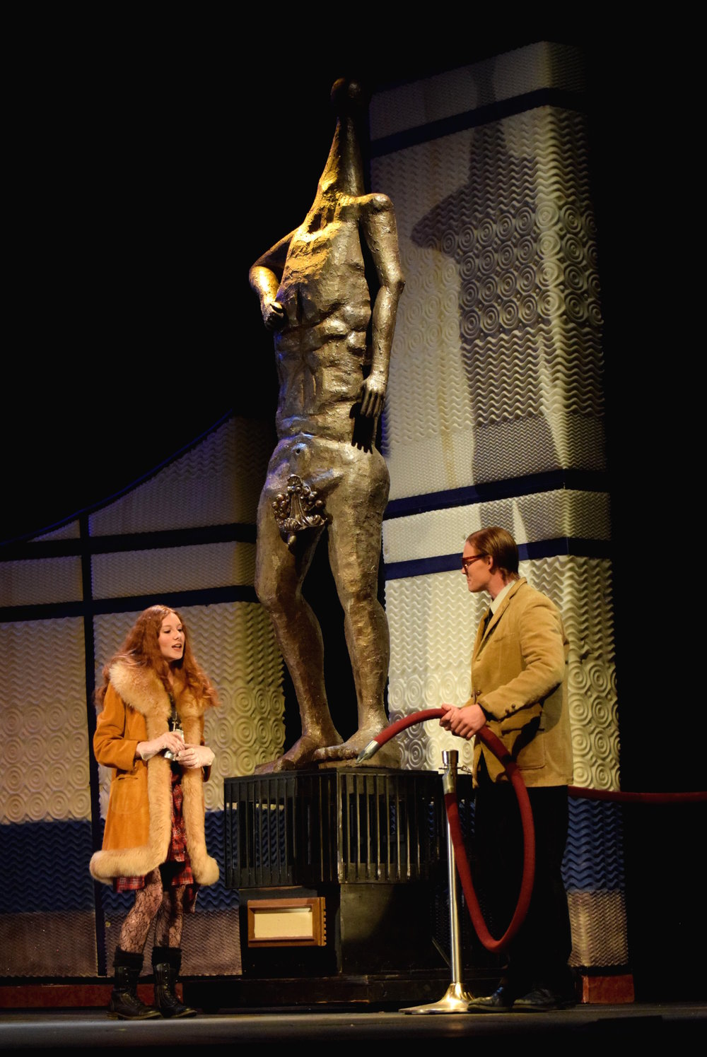 Evelyn and Adam discuss her plan to deface the statue.