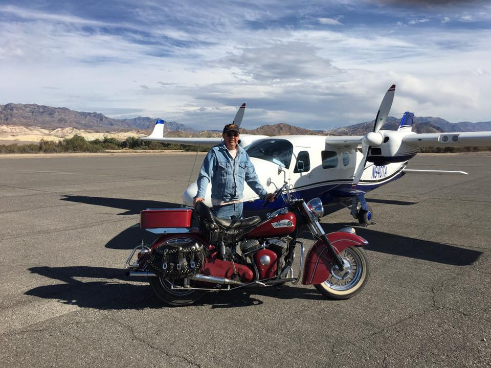 "Gary Stark flew in for the Death Valley Run. Here he is with ""Big Red,"" which has logged more than 250,00 miles."