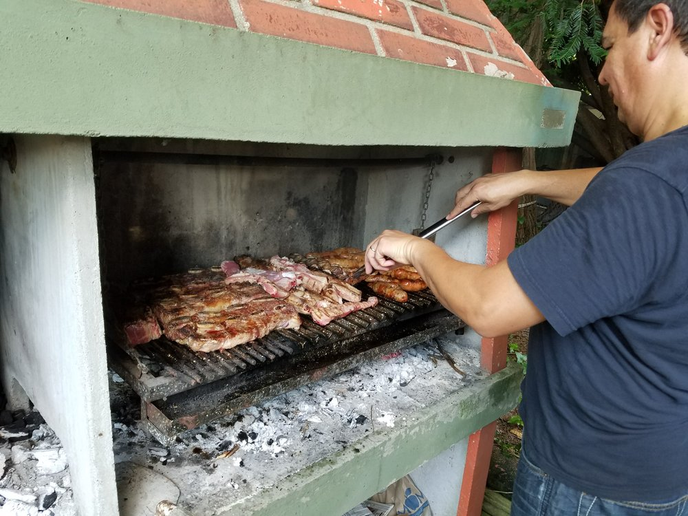 Armando manning the parilla (grill) for us after workshop!
