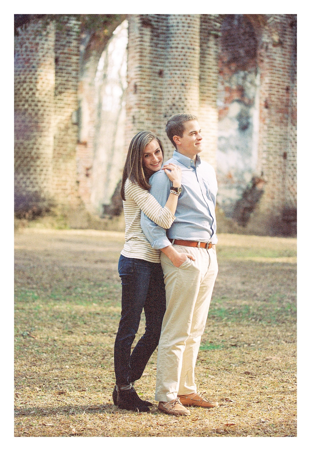 Beaufort engagement photographer captures couple embracing during engagement photos at Old Sheldon Ruins in Beaufort, SC