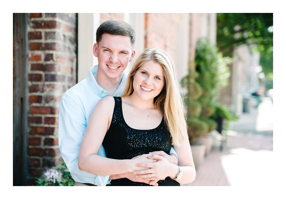 Charlotte engagement photographer captures couple on sidewalk during their  engagement session in Charlotte, NC