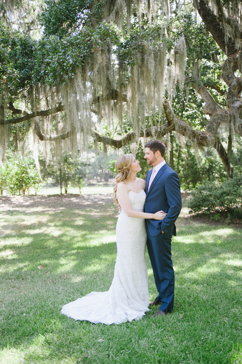 first look under spanish moss at Legare Waring House wedding designed by OOH! Events