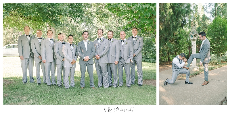 groomsmen in grey suits pose with groom