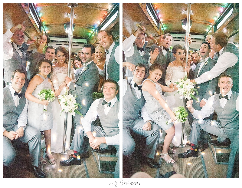 bridal party posing inside trolley