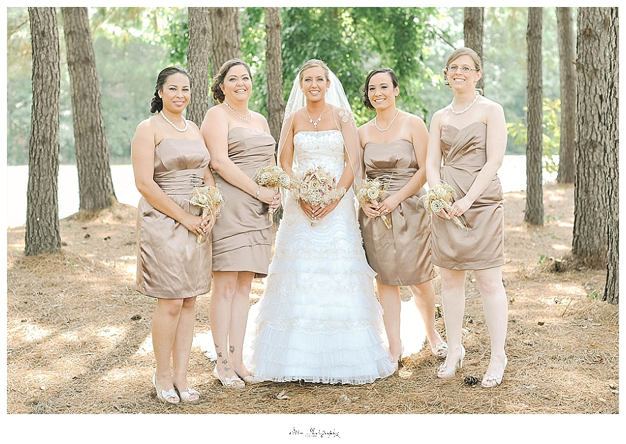 wedding party photo of bridesmaids wearing neutral dresses