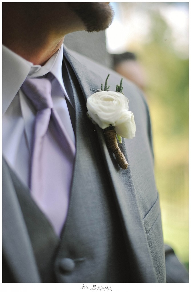 detail of purple tie with ribald farms boutonniere creation