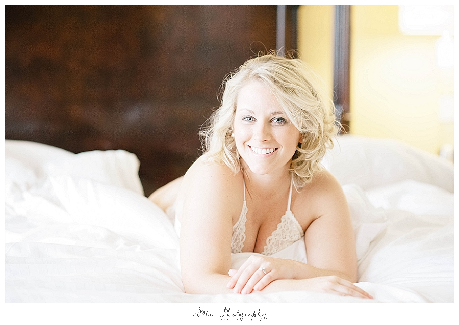 boudoir photo of woman laying in bed