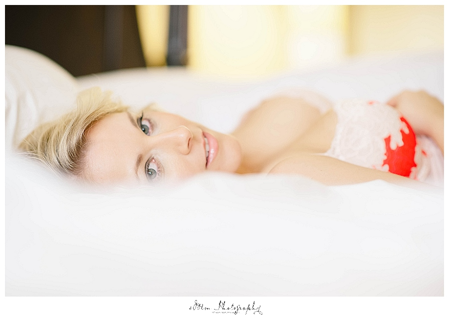 woman laying in sheets