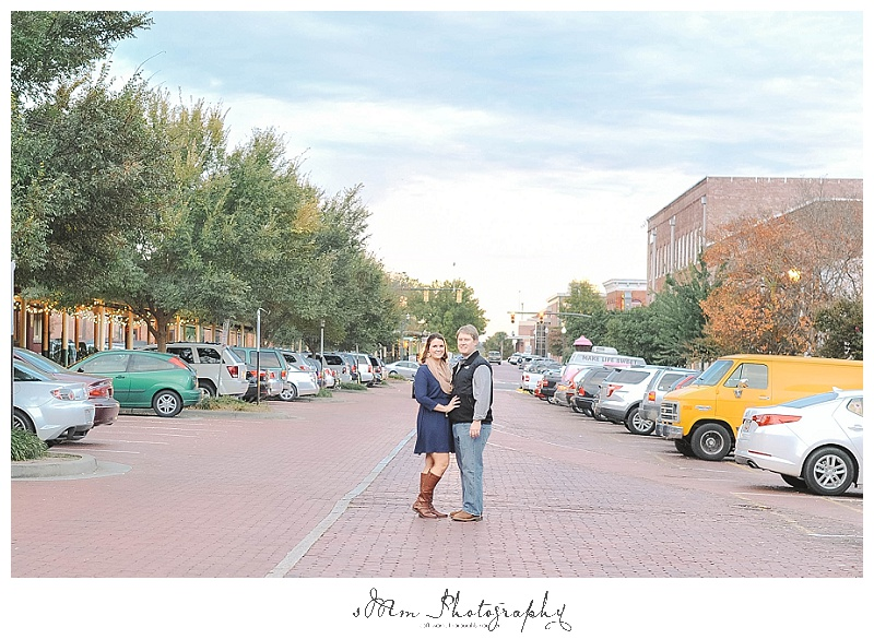 couple standing in street at sunset in Columbia, SC