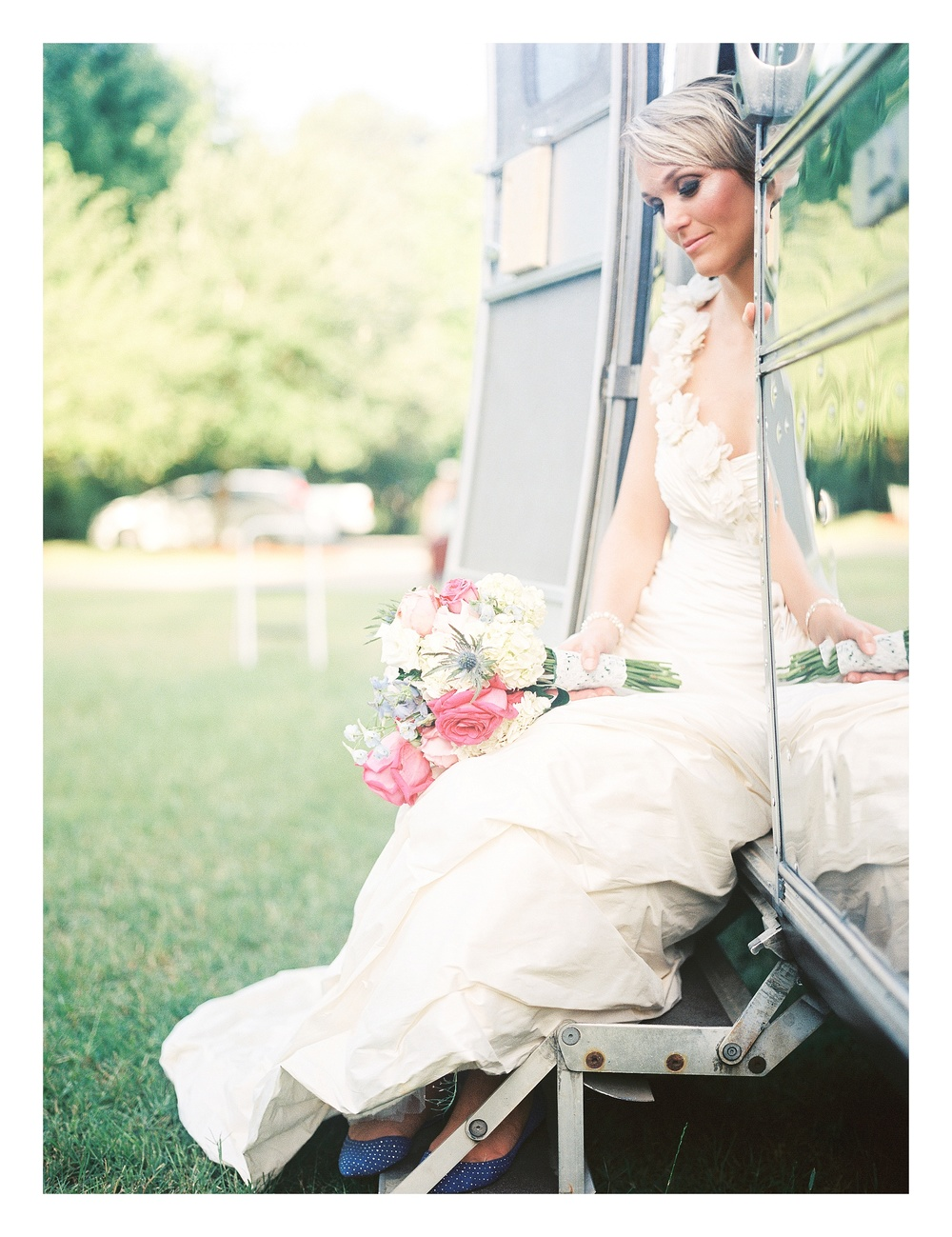 Charlotte wedding photographer captures bride on an airstream trailer for commercial photos for Southern Smokes Cigars