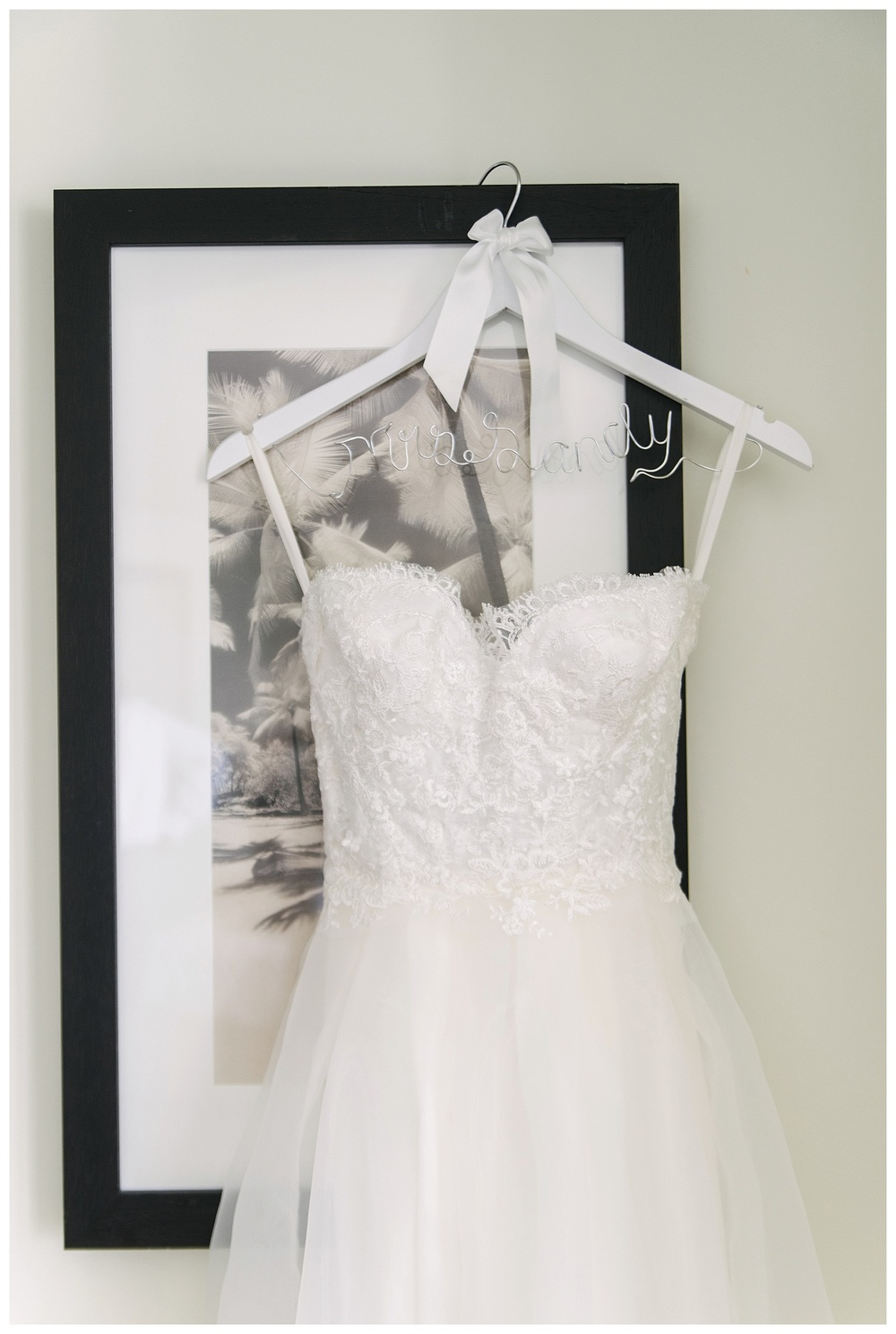 bride's dress hanging inside honeymoon suite of Aruba Marriott Resort
