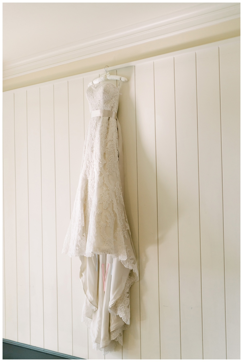 wedding dress hanging inside daniel island club